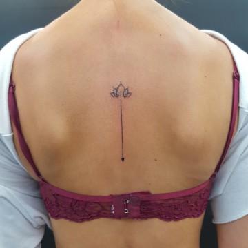 arrow georgina back tattoo