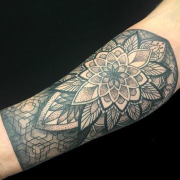 Petra mandala arm primitive tattoo