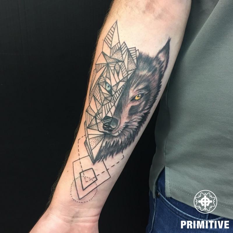 wolf geometric realistic forearm petra primitive tattoo